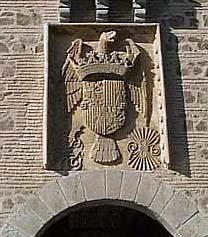 Puerta de Alcántara, escudo de los Reyes Católicos