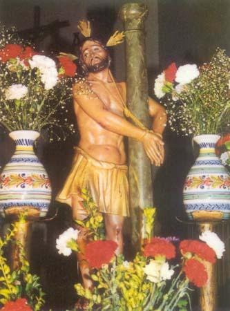Cristo del Amparo, con flores